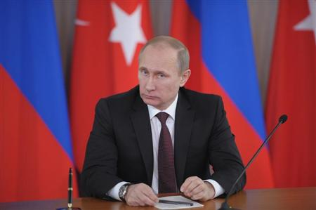 Russia's President Vladimir Putin attends a news conference in Strelna near St. Petersburg