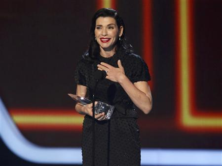 "Actress Juliana Marguiles accepts the award for favorite network TV drama for her show ""The Good Wife"" at the 2014 People's Choice Awards in Los Angeles"