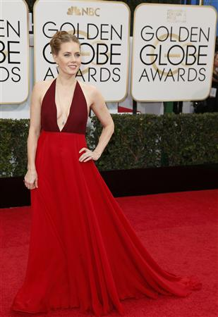 Amy Adams arrives at the 71st annual Golden Globe Awards in Beverly Hills