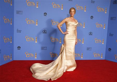 Actress Anna Gunn poses backstage at the 71st annual Golden Globe Awards in Beverly Hills