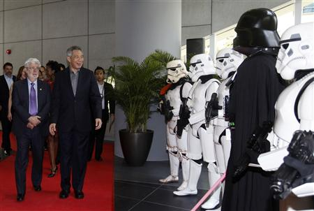 Filmmaker George Lucas welcomes Singapore's Prime Minister Lee Hsien Loong during the opening of Lucasfilms' new animation production facility in Singapore