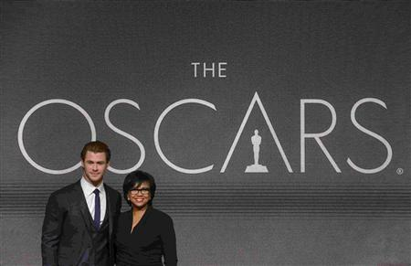 Actor Chris Hemsworth and Academy of Motion Picture Arts and Sciences President Cheryl Boone Isaacs pose for photographers after the 86th Academy Awards nominee announcements in Beverly Hills