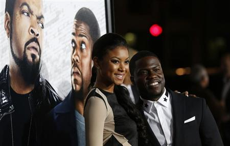 "Cast member Kevin Hart and Eniko Parrish pose at the premiere of ""Ride Along"" at the TCL Chinese theatre in Hollywood, California"
