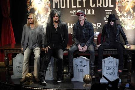 Members of rock band Motley Crue pose at a news conference announcing The Final Tour in Hollywood