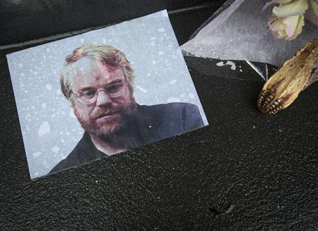 A photo of actor Philip Seymour Hoffman is pictured as part of a makeshift memorial in front of his apartment building in New York