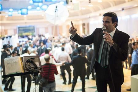 Israeli singer Zion Golan performs at a wedding celebration in Netivot