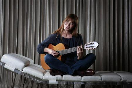 "Singer Carla Bruni-Sarkozy sings as she poses for a portrait to promote her new album ""Little French Songs"" in New York"