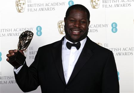 "Director Steve McQueen celebrates after winning Best Film for ""12 Years a Slave"" at the British Academy of Film and Arts awards ceremony at the Royal Opera House in London"