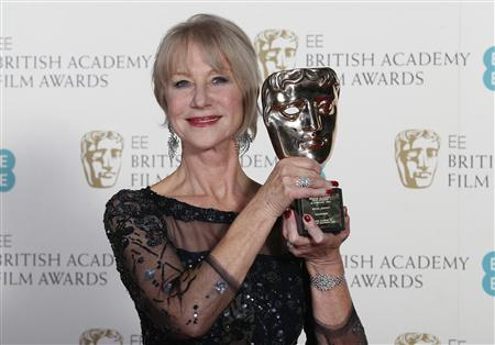 Helen Mirren celebrates winning the Fellowship award at the BAFTA awards ceremony in London
