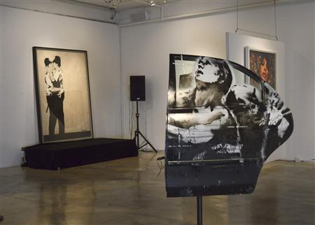 Banksy paintings are on display at LMNT Gallery in Miami, Florida