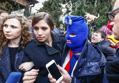 Members of Russian punk band Pussy Riot speak to journalists during the 2014 Sochi Winter Olympics in Adler