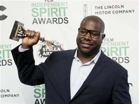 "Director Steve McQueen poses backstage with his Best Feature award for the film ""12 Years a Slave"" at the 2014 Film Independent Spirit Awards in Santa Monica"