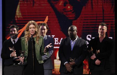 "Producer Gardner accepts the Best Feature award with the cast and crew of the film ""12 Years a Slave"" at the 2014 Film Independent Spirit Awards in Santa Monica"