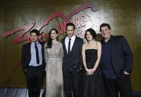 """Director of the movie Murro poses with cast members O'Connell, Green, Mulvey and Headey at the premiere of """"300: Rise of an Empire"""" in Hollywood"""
