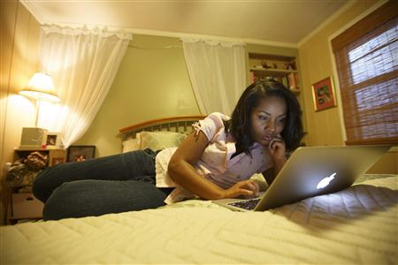 Dittenber checks her Facebook page in friend's home in Nashville