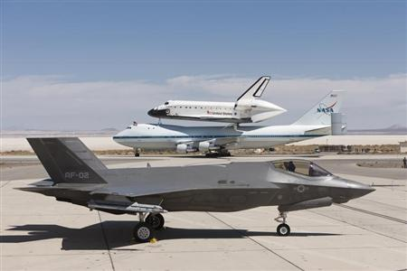 Lockheed Martin F-35 JSF is pictured with space shuttle Endeavour mounted atop its 747 SCA at 461st FLTS JSF Integrated Test Force at Edwards Air Force Base, California