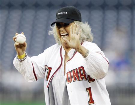 File photo of Food Network personality Paula Deen laughing before throwing out the first pitch prior to the Washington Nationals versus New York Mets MLB baseball game in Washington