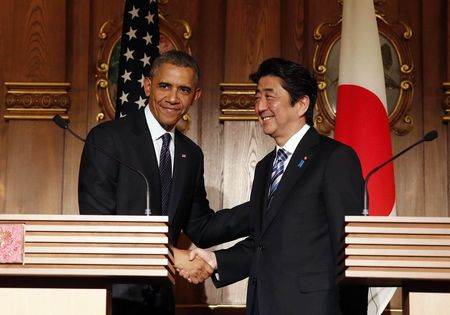 U.S. President Barack Obama shakes hands with Japan's Prime Minister Shinzo Abe at a joint news conference at the Akasaka Palace in Tokyo