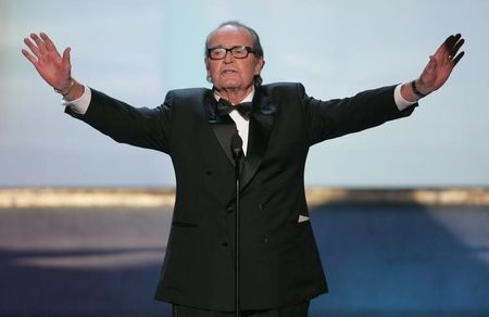 James Garner holds out his arms at the 11th annual Screen Actors Guild awards.