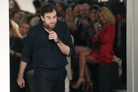 French designer Christophe Lemaire appears at the end of his Spring/Summer 2013 women's ready-to-wear fashion show for fashion house Hermes during Paris fashion week