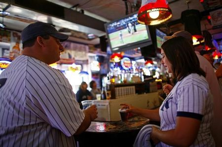 Patrons watch the game at Stan's bar outside Yankee Stadium in the Bronx borough of New York