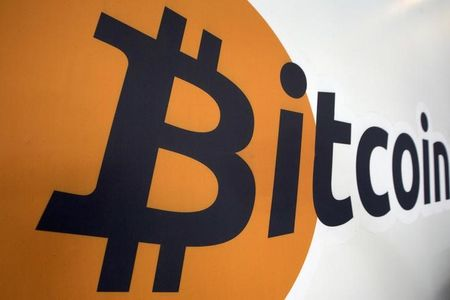 A Bitcoin trademark is displayed during a Bitcoin Center New York City in New York's financial district