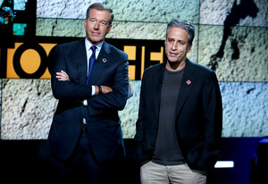 Brian Williams and Jon Stewart | Photo Credits: Heidi Gutman/NBC