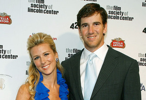 Abby Manning and Eli Manning | Photo Credits: Mark Von Holden/Getty Images