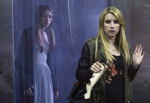 Taissa Farmiga and Emma Roberts | Photo Credits: Michele K. Short/FX