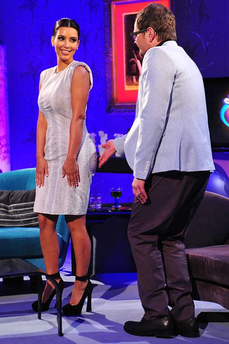 "Kim Kardashian Lets British TV Host Alan Carr Grope Her ""Big Butt"""