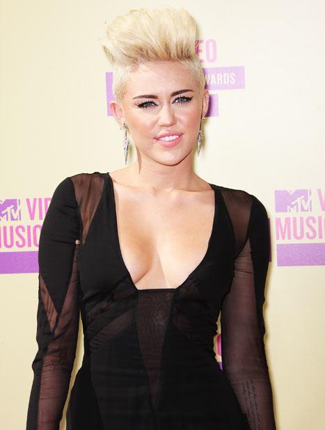 Miley Cyrus Avoids Scissor-Wielding Intruder