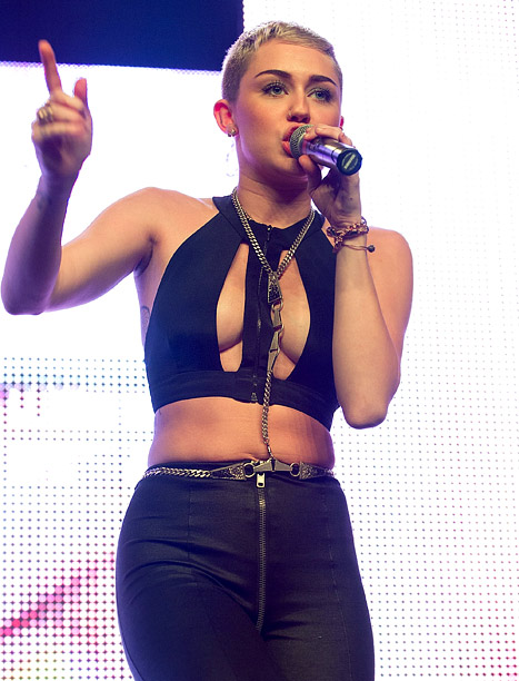 PICTURES: Whoa! Miley Cyrus Dances With Topless Stripper, Flashes Cleavage in Tiny Cut-Out Top in Shocking Concert