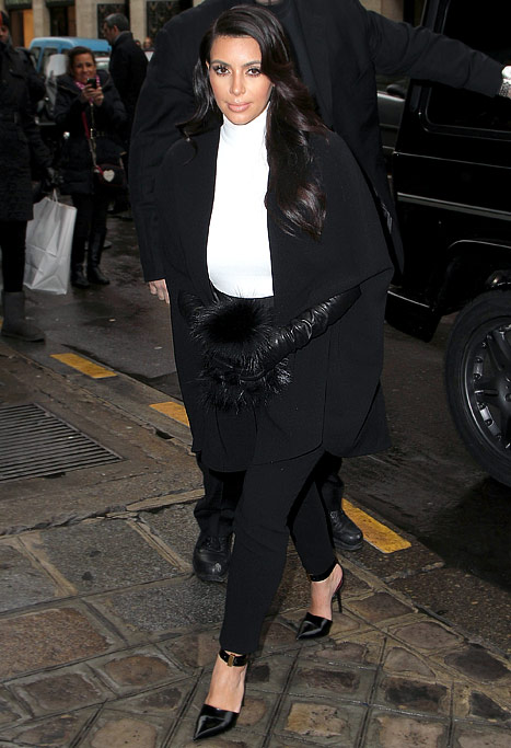 Kim Kardashian Hides Baby Bump in Black and White Outfit at Paris Fashion Week
