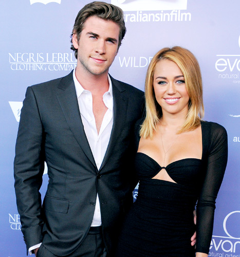 "Miley Cyrus, Liam Hemsworth Reunite in L.A., Are ""Happy"" Together"