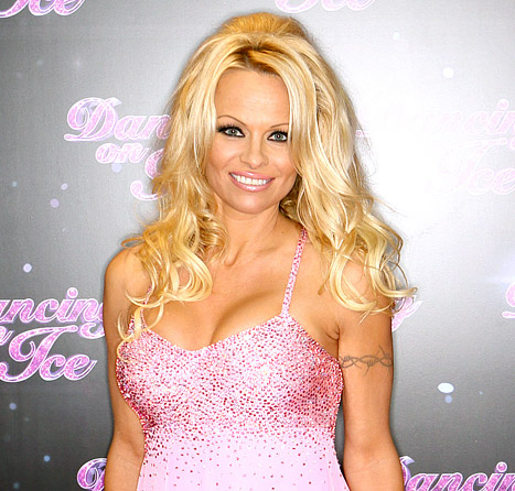 "Pamela Anderson Ad Banned in Britain for Being ""Sexist and Degrading to Women"""