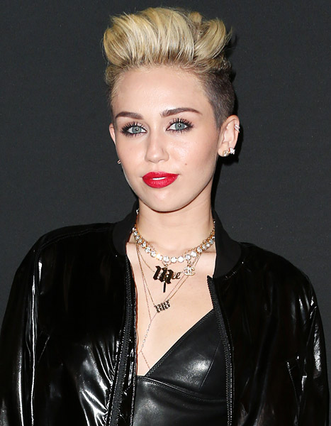 """Miley Cyrus Talks Liam Hemsworth, Says Alcohol Is """"Way More Dangerous"""" Than Weed"""