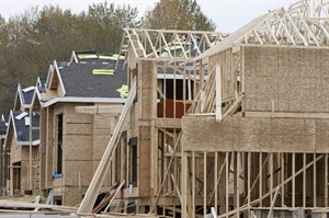 New homes being built are shown in Abbotsford, B.C., Oct. 27, 2007. THE CANADIAN PRESS/Jonathan Hayward