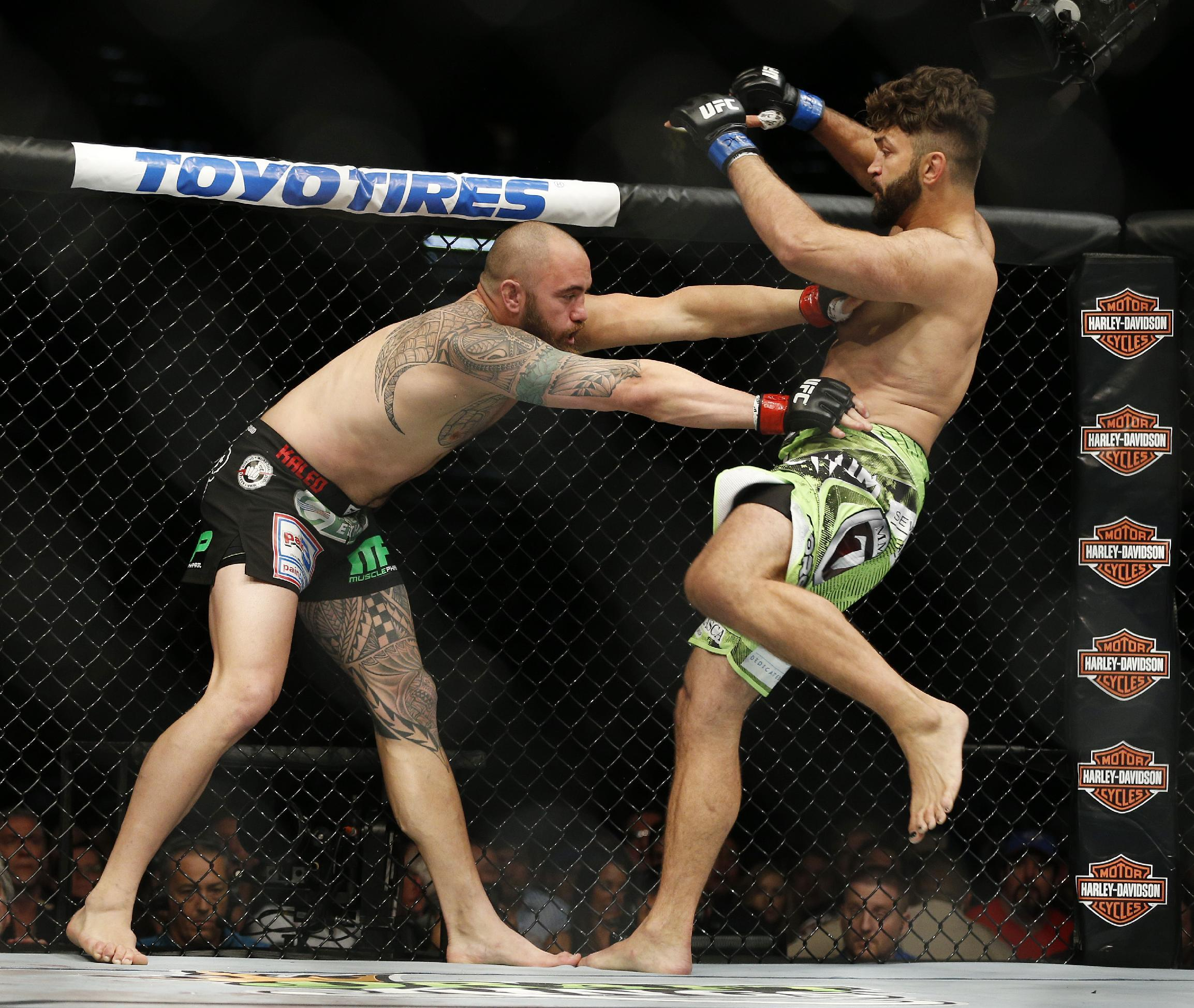 Andrei Arlovski (R) and Travis Browne engage during their heavyweight fight. (AP)