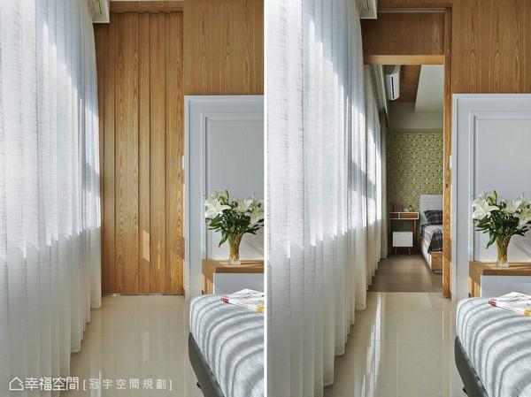 木作凹凸變化的立面景緻,看似對稱的牆面造型收尾,其實是主臥房與次臥動線,隱藏式的拉門推開後,引介主臥床頭清爽的綠色為端景,豐富景深層次。
