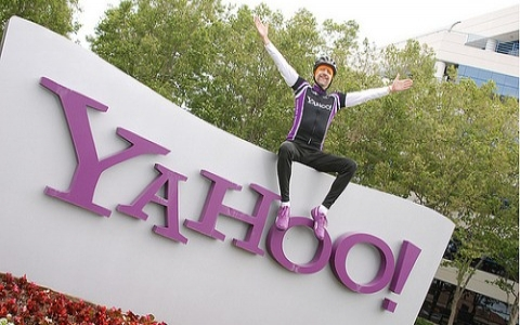 biker sitting on yahoo sign