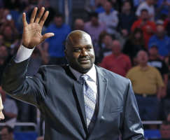 Former NBA basketball player Shaquille O'Neal waves to fans as he is honored during an NBA basketball game between the Orlando Magic and the Detroit Pistons...