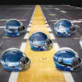 Navys badass helmets have hand-painted ships, custom for each position group
