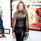 Elizabeth Hurley, 50, Shows Off Her Enviable Body in a See-Through Lace and Leather Getup
