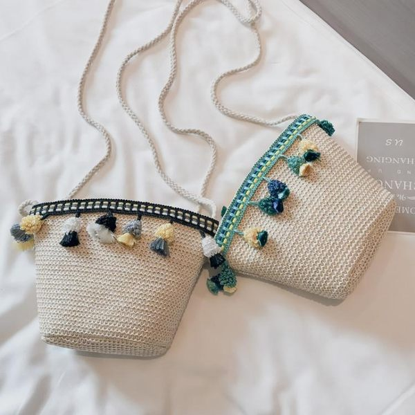 夏天仙女包包2019新款海邊度假草編包個性流蘇水桶包單 【四月上新】