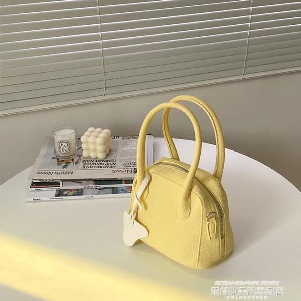 貝殼包 小眾設計奶黃色貝殼包女手提荔枝紋側背斜背包百搭包包2021新款潮 新品