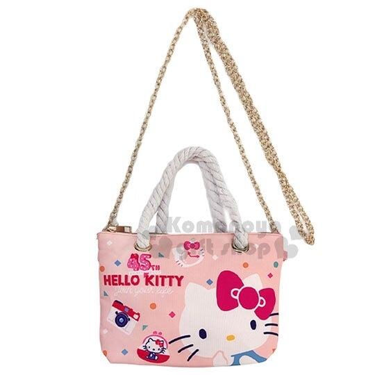 〔小禮堂〕Hello Kitty 尼龍麻繩斜背觸控手機包《粉.45週年》手提包.化妝包.斜背包 4711907-31001