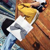 側背包 蝴蝶結單肩大容量帆布包袋學生手提布包《小師妹》f495