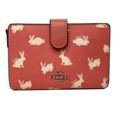 【COACH】滿版兔兔們鈔票零錢袋中夾(粉)