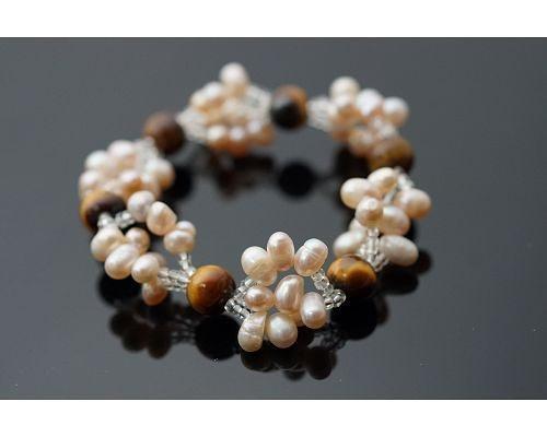 虎眼石粉色珍珠手鍊 提高自信和實行力! 寓意圓融美滿幸福壽富足的真珠,更是雍容華貴的象徵。