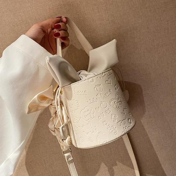 水桶包 百搭ins包包女夏2021新款潮時尚網紅斜背包高級感小眾手提水桶包 晶彩 99免運